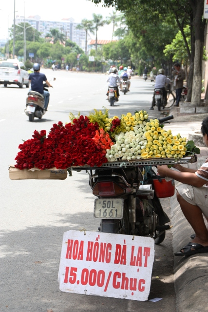 Flower seller on the side of the road in Ho Chi Minh City, Vietnam