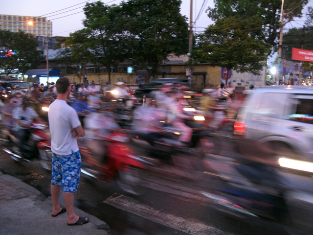 Waiting to cross the street in Ho Chi Minh City, Vietnam